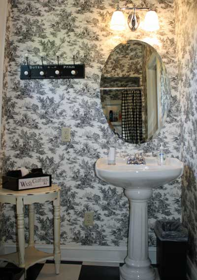 Bathroom with pedestal sink and oval mirror
